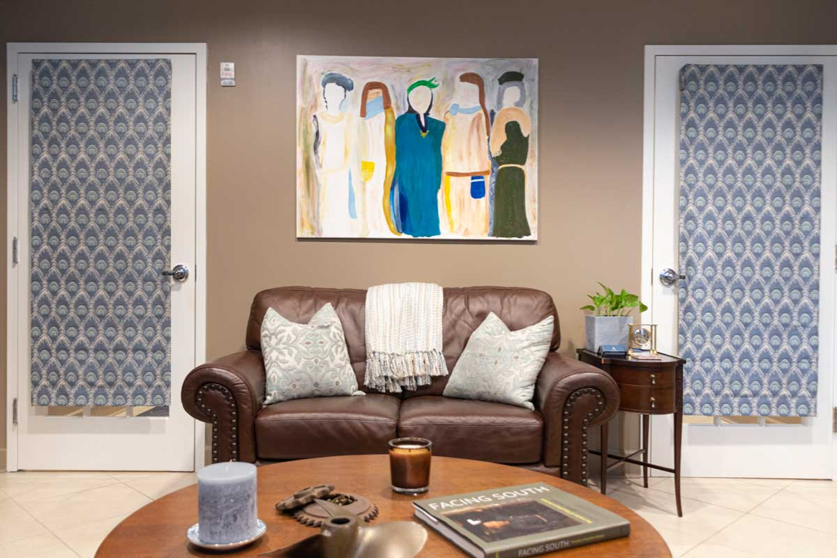 office image sofa and women painting Angela F. Arnold, MD 5505 peachtree dunwoody rd Atlanta GA