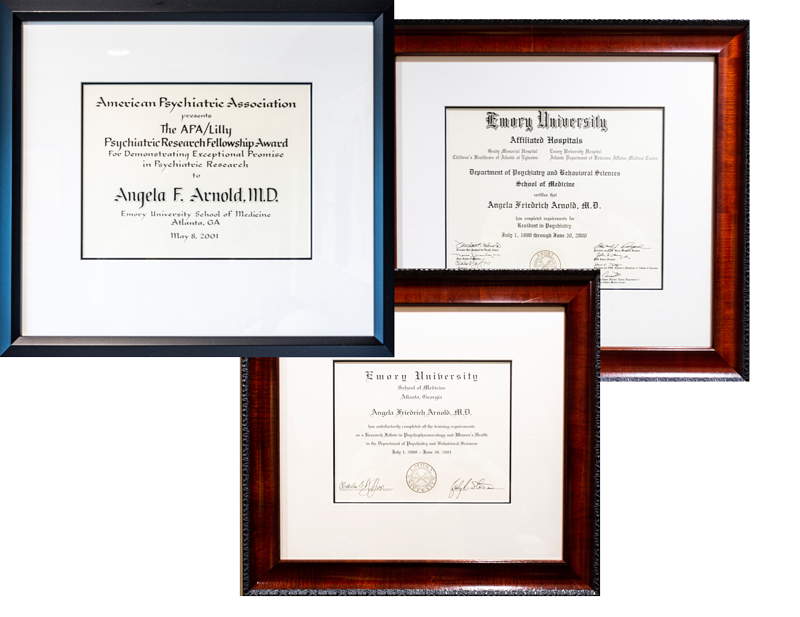 Three framed awards, diplomas dr angela arnold md emory university fellowship award